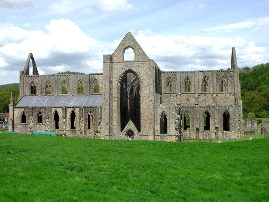 The picture shows the west front of Tintern Abbey with the great window to the left.