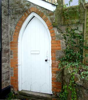 St Arvan Meeting Rooms is shown only by the arched door as the buiding nestles between two other properties.